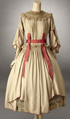 1910s Late teens1919., 1917-. The fabric feels like a cotton/silk blend. The design is a very fashion forward dress for the period with its bell shaped skirt. This is the time period of Paul Poirot an