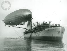 """planeshots:    ZR-3 USS Los Angeles. """"U.S. [Navy] Airship Los Angeles [ZR-3] moored to ship first time. The U.S.S. Patoka, first U.S. Navy dirigible tender, steaming up Chesapeake Bay from Baltimore with the U.S. Los Angeles, lastest addition to the U.S. air fleet, moored to its mast. It was the first ship-mooring test of the former ZR-3 and lasted 55 minutes, being curtailed because of storm warning, January 16, 1925'…Credit: unknown (Smithsonian Institution)"""