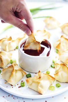Baked Cream Cheese Wontons (Rangoon)- Healthier, crispy Asian wontons stuffed with melty cream cheese, ready to dip into your favorite sweet and sour sauce!