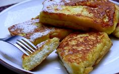 Cannoli French Toast From Everyday 1/4 cup confectioners' sugar plus more for dusting 1 cup ricotta cheese 2 eggs 1/2 cup milk 12 slices sandwich bread, crusts removed 2 Tablespoons extra-virgin olive oil