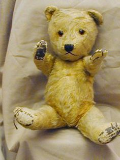 'Chiltern' teddy bear. Straw stuffed bear with jointed head and limbs. Glass eyes. Slightly loved.