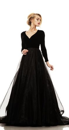 The combination of a soft silk velvet long sleeved bodice and a full organza skirt creates a fresh new twist on classic elegance. Pair with a belt to add a mode