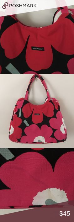 Marimekko zip top tote Bright floral print hides a few marks (see pic). Roomy tote with zip top. 18 inches long by 12 tall. 11 inch handle drop. Good condition. Smaller zip compartment inside large main compartment. Non smoking. Marimekko Bags Totes