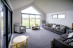 Brodie & Niki Retallick's separate living room with floor to ceiling windows allowing plenty of natural light into the room #windows #livingroom #house #interiordesign #brodieretallick #generationhomes