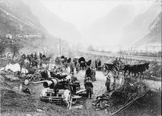 German horse-drawn transport convoy passing an Austro-Hungarian 30.5 cm Skoda heavy howitzer near Flitsch (Bovec) in the River Isonzo valley. THE BATTLE OF CAPORETTO, OCTOBER-NOVEMBER 1917