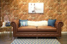 """Our version of the classic Chesterfield design, this completely handmade Antique Brown Leather Sofa offers rustic comfort for any space. Supported by a solid kiln dried wood frame and reclaimed Oak legs this sofa is built to last.  90.55""""W x 40""""D x 32.3""""H http://www.bohofurnituregallery.com/BOHO_Classics_Book_1-Durango_Antique_Brown_Leather_Sofa.html"""