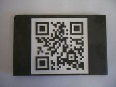 Engraved slate QR Code. We were asked to do this QR code as part of a larger plaque and to test I made this example. It really works - try it with your barcode scanner!