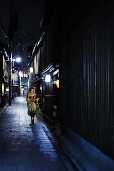 My sister Leslie and I chased a geisher down this very street in Kyoto to get a very similar picture of a rare geisha girl.
