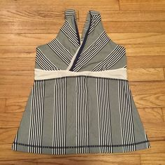 Lululemon striped navy/white gym tank top - sz 8 Lululemon striped navy/white gym tank top - sz 8. Armpit to armpit - 18.5 inches. Length - 21 inches. Excellent used condition. lululemon athletica Tops Tank Tops