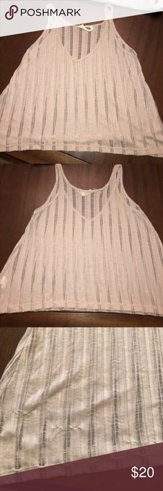 Show Me Your Mumu (Mellow)  Tank Might be a crop on some people - I'm 5'5 and it's perfect with high waisted jeans! There are a few pulls at the bottom due to the material of the shirt (see picture). Show Me Your MuMu Tops Tank Tops