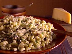 Get Giada De Laurentiis's Thimbles with Mushrooms and Artichokes Recipe from Food Network