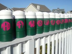 These would be super easy to duplicate!  You can order monogram stickers on Etsy for like 5 bucks. You would just have to apply them to a regular cooler.