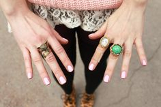 pretty nails and rings.