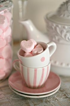 Marshmallow hearts in pink and white cups.