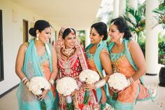 Peach and turquoise bridesmaids. Photo by Sara Wilde