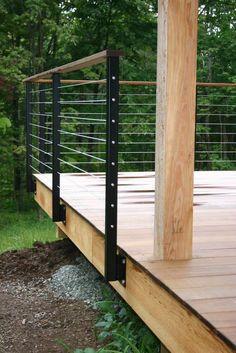 modern cabin: deck railing, metal railing posts, wire, wood