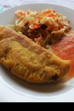 Pasteles rellenos con curtido y salsa.....only need to try them once to become addicted to thier delicious taste!!
