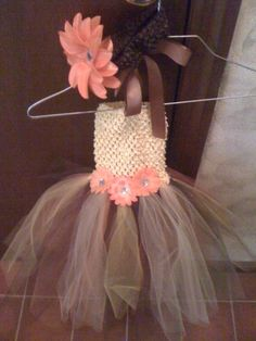 Yellow crochet top with tulle bottom.  Three orange flowers.  Matching headband with large orange flower.  @Paige Hereford Gross
