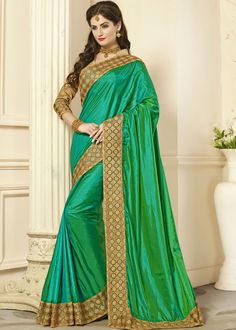 #Green two toned paper #silksaree enhanced by decorative #lace borders in #golden.