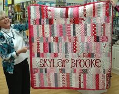 """Check out Cyndi's newest addition - that is to say, this quilt which she made for her new grand-baby, Skylar. I just love the softness and extra """"cuteness"""" of this quilt she created and how about the personalization! She appliqued letters that she traced from one of Nancy Halvorsen's """"Art to Heart"""" books!"""