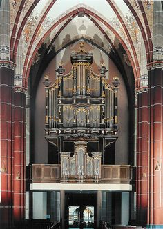 Organ in St. Cyriakus Catholic Church in Krefeld-Hüls, Weeze, Germany. Size is shown off by the very small doors beneath the pipes.