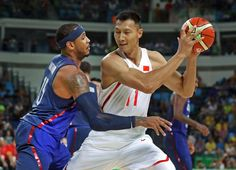 Melo defends:    China center Jianlian Yi handles the ball against United States forward Carmelo Anthony in the men's basketball Group A preliminary round on Aug. 6 at Carioca Arena.