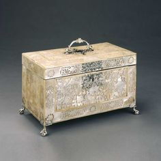 mother of pearl tea caddy, mid 18th century silver mounted mother-of-pearl casket, finely carved throughout with flowers and leaves, with pierced silver carrying handle