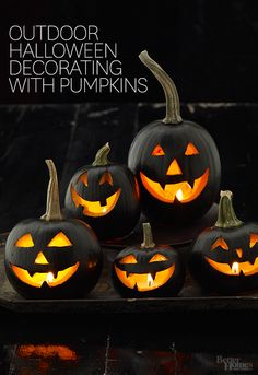 Black Pumpkin Display - Grinning jack-o'-lantern faces will be all you'll see on Halloween night with this collection of black carved pumpkins. Simply paint your jack-o'-lantern with black acrylic or spray paint before carving. Use painter's tape around the stems to keep them paint-free.