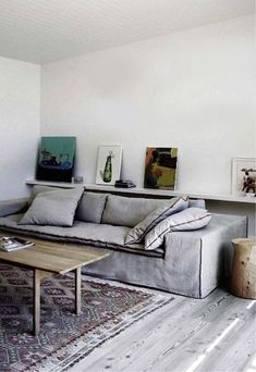 { grey living room with kilim and photo shelf }