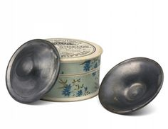 A pair of English Dr Wansbrough's lead nipple shields in their original round container. 1880 - 1900.     Nippleshieldswere made from a variety of materials in the 18th and 19th centuries, wood, ivory and silver the most common. They were intended to protect the mothers sore nipples.They were often perforated allowing the baby to (theoretically)  feed through them.These unperforated examples would have been removed before feeding. The dangers of lead poisoning were well known...