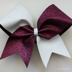 Two color glitter bow. Maroon and white glitter cheer bow
