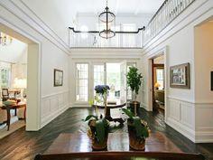 Hamptons living Inspiration. White walls. Dark floorboards. High ceilings.