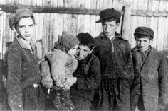 Kovno, Lithuania, A group of young boys holding a small child in the ghetto. They will be sadly marched to a ditch and shot in the back of the head