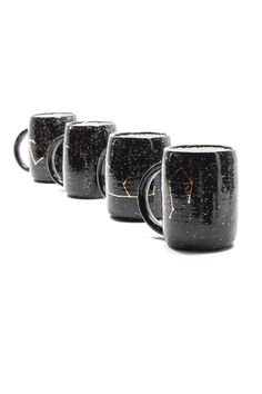 THESE MUGS. Space-black with gold constellations and handmade in Seattle. So good!