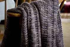 Free pattern on Ravelry: Garter Rib Baby Blanket pattern by Orange Flower.  Pattern for Aran/Worsted weight, but easily adaptable.