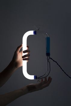 Italian product design graduates Francesco Rogante and Ilaria Pirro have developed a rotating lamp that uses the electrical conductivity of liquid in place of a switch.  Called Circuiti Liquidi, or liquid circuits, the project aims to combine two elements that are generally seen as an oppositional pairing: liquid and electricity.  The tubular lamp has two bases, which the user alternates between as they turn the lamp upside down and back again in order to activate the light. Smart Materials, Shape And Form, Automotive Design, Design Trends, Lighting, Tube, Circuits, Product Design, Empty