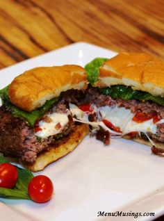 Caprese Stuffed Burgers - filled with all of my favorite ingredients... oozing out when you bite into it! Yum!!