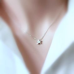 Silver Star Necklace, Silver Star Pendant on Sterling Silver Necklace Chain. $18.00, via Etsy.