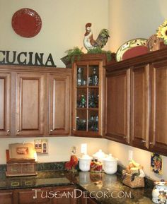 pleasing decorating the top of kitchen cabinets. The Tuscan kitchen style is one of the most popular decorating trends  today People love above cabinets tuscany Here s a closer look