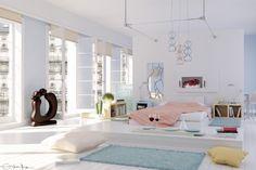 Camera da letto ampia con colori pastello