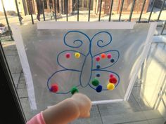 Toddler Activity - pom poms and contact paper!