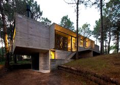 Slabs of board-marked concrete form the walls, floors and roof of this holiday home near Buenos Aires