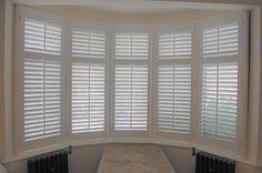 Bay window wooden plantation shutters in full height with our 63mm slat size in silk white