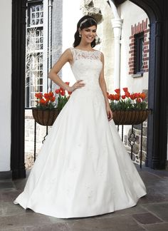 Sincerity wedding dress style 3737 This satin A-line gown has a tulle and lace Sabrina neckline, a V-back,  buttons that cover the back zipper, and a detachable chapel length  train.