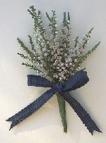 white heather is traditionally worn or used as good luck at weddings in Scotland! I like the navy ribbon with this?