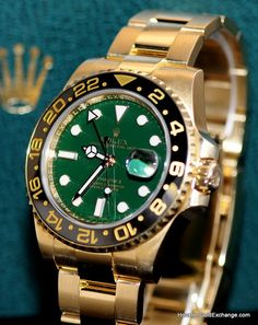18K Rolex GMT Master II with the Green Anniversary Dial and Black Ceramic Bezel.