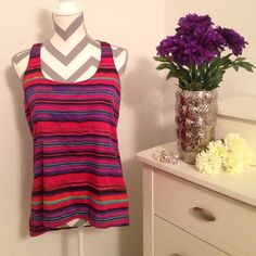 Stripped Multi Colored Top This shirt can be formal or casual! This shirt is longer in the back! Gently used! Eyeshadow Tops Muscle Tees