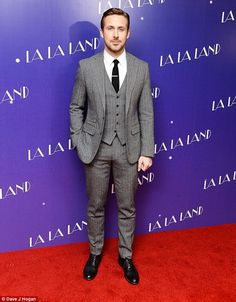 Dapper: Ryan wowed in a fitted three-piece grey suit as he arrived on the red carpet
