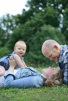 love the interaction between mom and dad, and then baby with the camera!