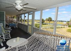 Sea 2 Views is a six-bedroom, five-bath second-row, channel-front home located 0.9 miles south of the Garden City Pier.